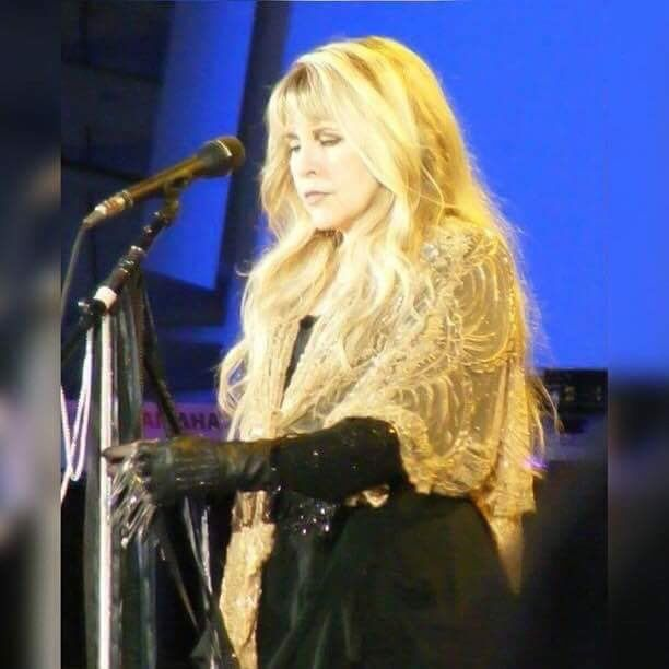 Stevie onstage   ~ ☆♥❤♥☆ ~    in a serious mood, wearing her awesome Gold Dust Woman shawl, with her long golden hair spilling down and over the shawl while on her '24 Karat Gold' Tour, November 4th, 2016 at the BB&T Centre, Fort Lauderdale, FL
