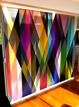 Feature wall that creates a 3D effect.  Colourful Wallpaper.