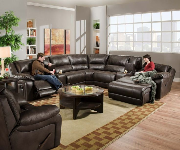 Modern black leather sectional sofa with chaise and round coffee table