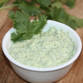 This amazing dip is made with cilantro & jalapenos.  It's very addicting!