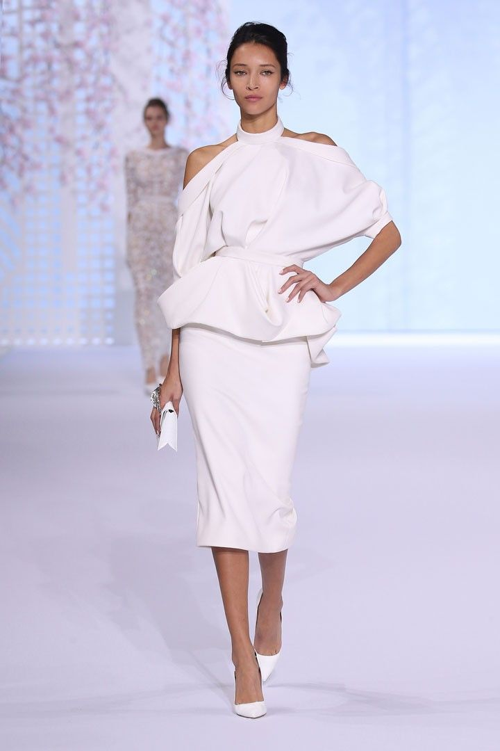 White silk matte crêpe draped tailleur with cowl back and cut out shoulders.