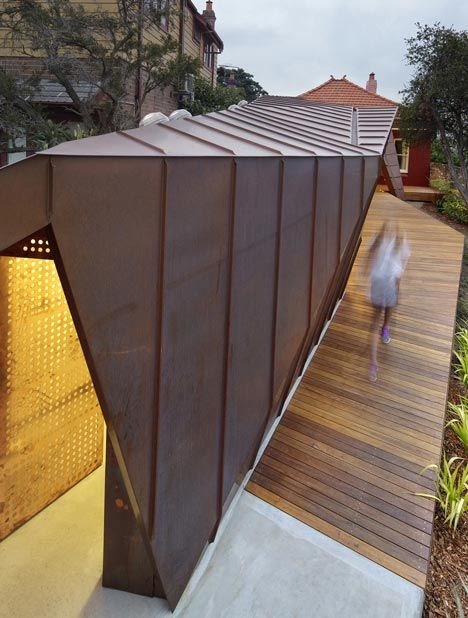 A house extension within a faceted copper envelope