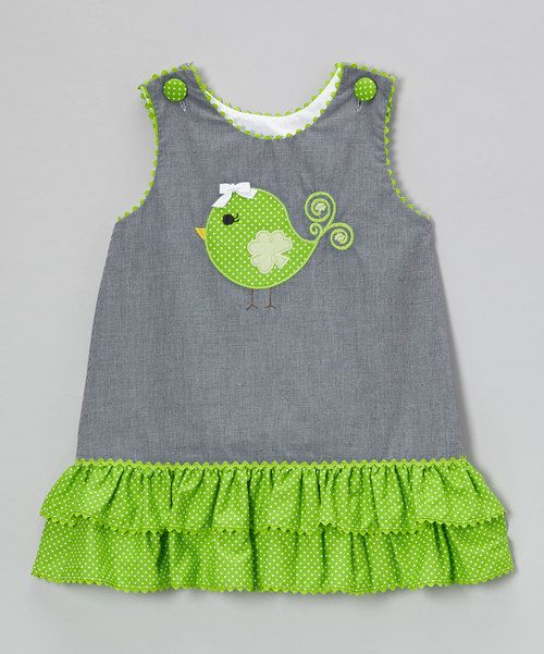 Lovely ruffles dance along the bottom of this pretty piece, adding fun-loving frills to its playful pattern and sweet appliqué. Charming little buttons on the shoulders and all-cotton construction make it easy-peasy to bring comfort and whimsy to a day full of play.