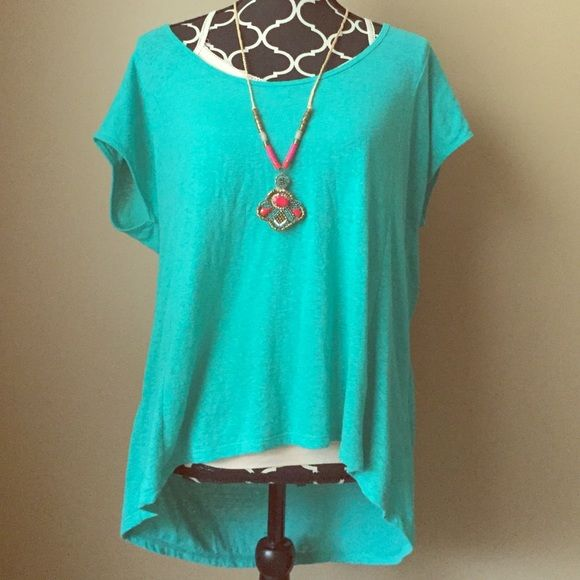 Oversized American Eagle hi-lo top This is such a pretty color. Label crossed out because it was purchased at an outlet. Perfect condition never worn because it's too big. It's a medium but would also fit a large because it's oversized. Listing is for top only. American Eagle Outfitters Tops