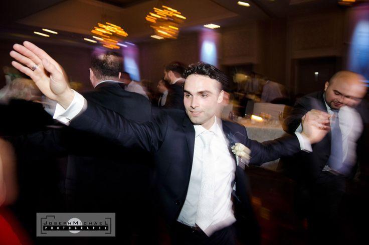 Hazelton Manor Wedding Photography, Groom on dance floor greek dancing, Orthodox greek wedding dancing