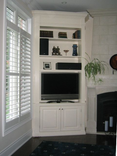 corner shelving idea. this would be amazing for our living room to help save some space.