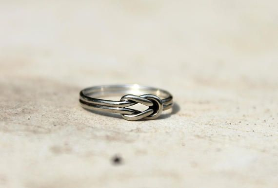 Beautiful handmade pinky ring with a symbolic meaning.  I carefully tied together a pair of 1mm sterling silver wires and form the symbolic lovers' knot, also known as the sailor knot.  The ring is very dainty and comfortable, therefore perfect in small sizes.
