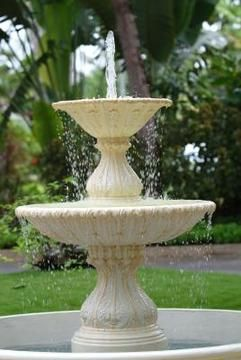 Painting a fountain can make it blend into or stand out from its surroundings.