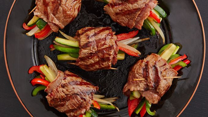 Tender steak rolls filled with zesty vegetables and drizzled with a glaze that is simply out of this world delicious.