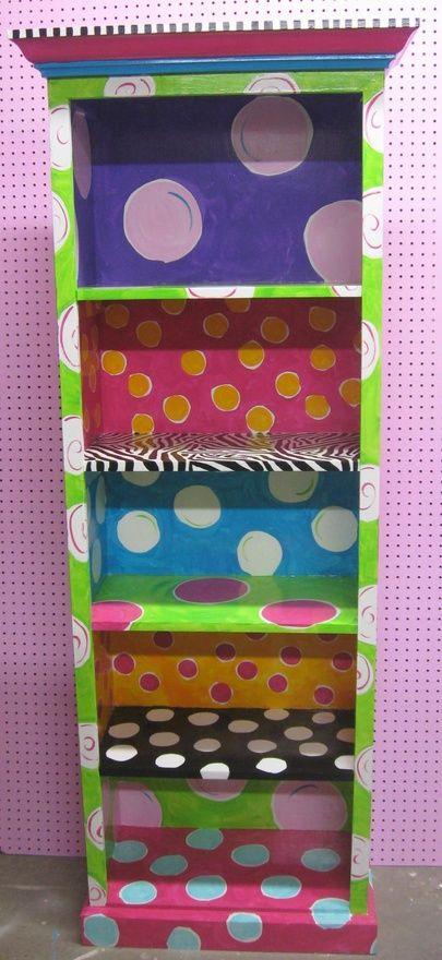 I would love to find an old bookcase to do this for my polka dot classroom.