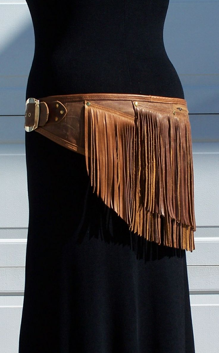 Brown leather fringe booty accent hip belt.  Made with rescued leather and other repurposed/recycled hardware.  Made by Zackra
