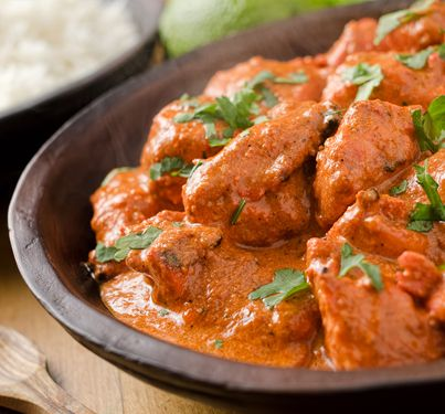 Indian Butter Chicken Recipe! A creamy sauce served with basmati rice and fresh cilantro.