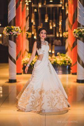 Light Lehengas - White Lehenga with Gold Print and Draped Dupatta | WedMeGood #wedmegood #indianbride #indianwedding #white #lehengas #bridal #lightlehenga #gold