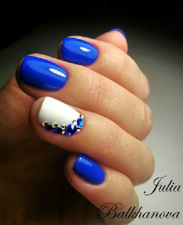 Blue and White Studded Nails. Courtesy by Julia Balkhanova, these blue and white studded nails are classy and elegant at the same time.