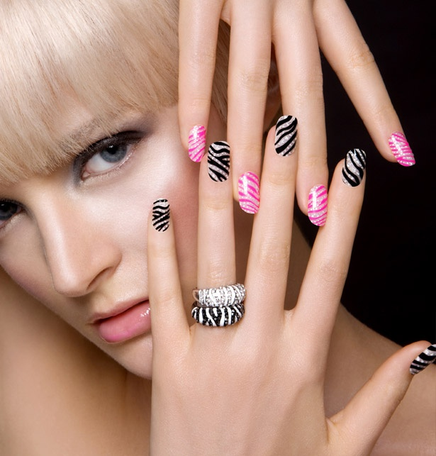 You know that nail stuff brand 'kiss'? They usually make sort of slutty press on nails. Well NOW they make these awesome nail decals. Highly recommended if you're brave enough to rock sparkle zebra nails!
