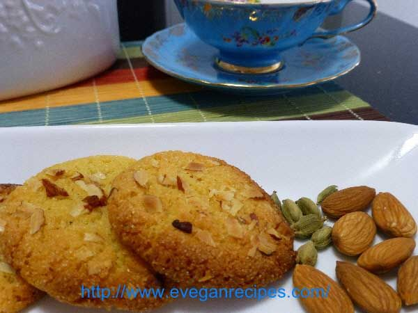 Easy Vegan Dessert – Almond And Cardamom Macaroons. These spiced #cardamom #macaroons have a sweet aroma of cardamom which enhances from the time they enter the oven and gradually spreads in the air. It invites all to enjoy the super crunchy and #nuttymacaroons.  Read more: http://www.eveganrecipes.com/easy-vegan-dessert-almond-cardamom-macaroons/