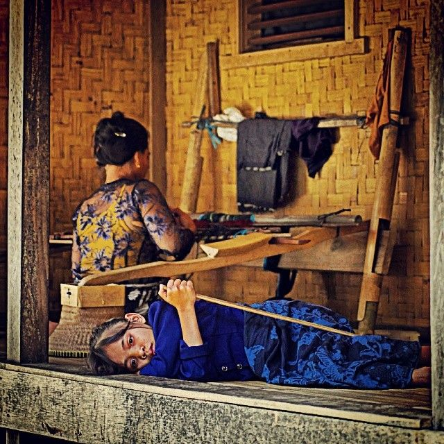 The Baduy kid Baduy women learn how to weave since childhood.