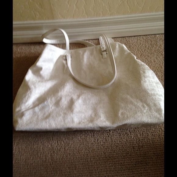 Armani exchange tote white Tote bag white Armani exchange blue stain in the bag see pictures new with tags Armani Exchange Bags Totes