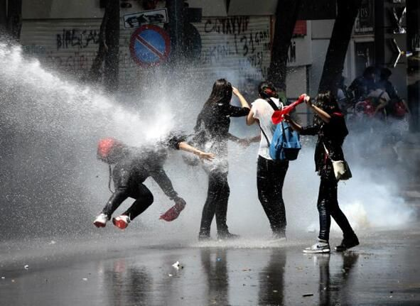Water canon targets a single protester in Ankara (time/date unknown)