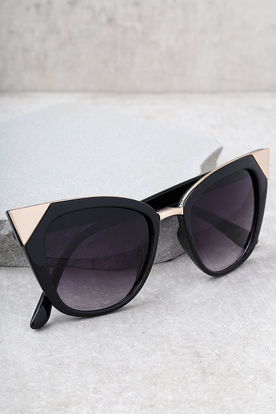 We have a whole-lot of love for the Modern Romance Black Cat-Eye Sunglasses! Black frames with matching tinted lenses flair to sleek rose gold tips. 100% UV Protection.