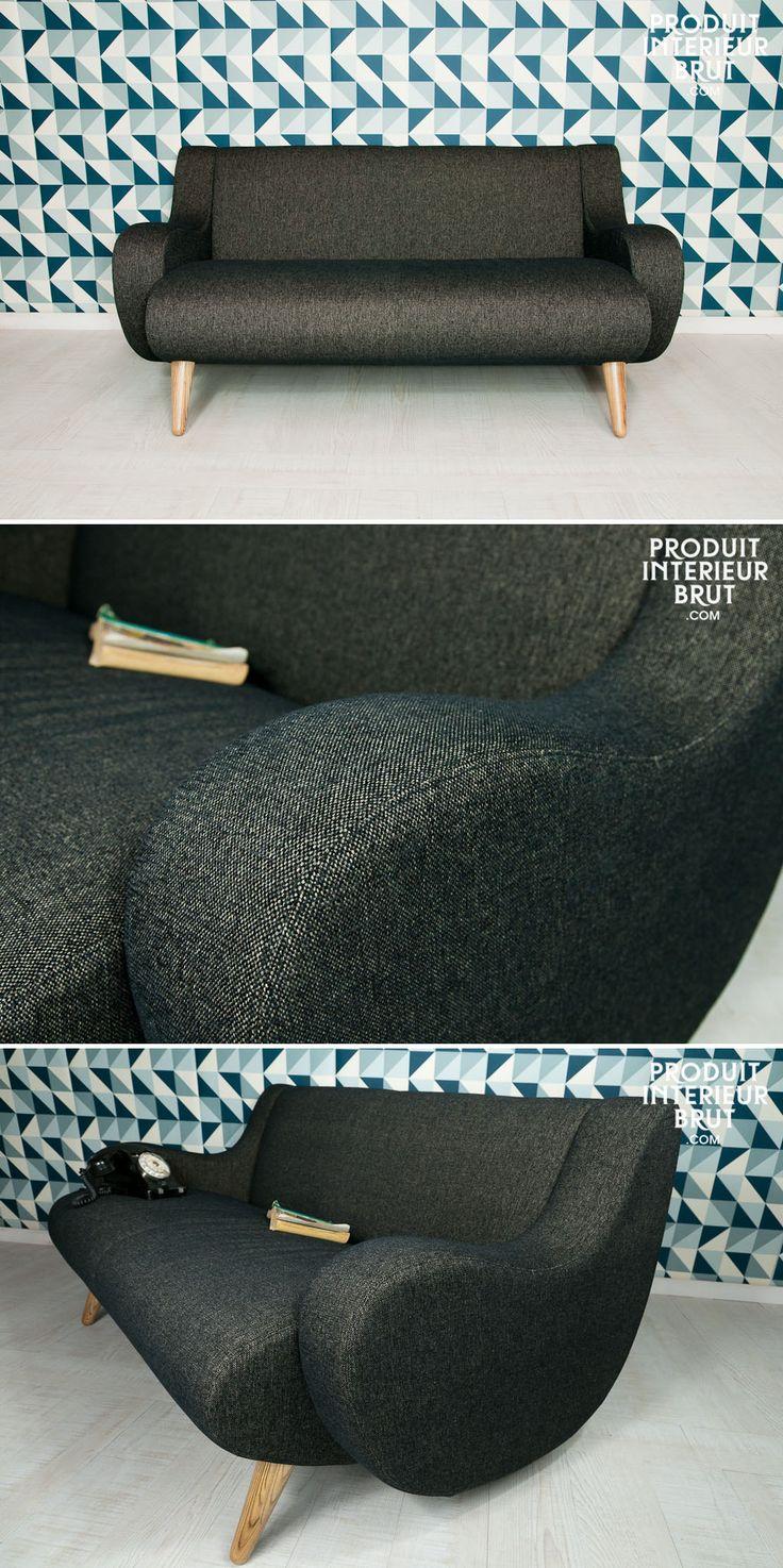 Ein gemütlicher Sessel mit runden Formen und angenehm zum Anschauen. In einem skandinavischem Stil.