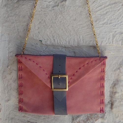 http://blomming.com/mm/Martigianato/items/borsa-a-busta-camoscio-rosa?view_type=thumbnail