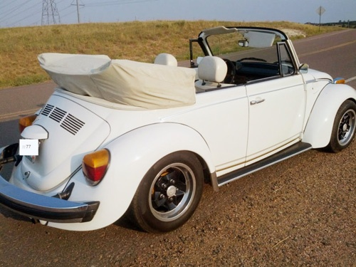 "For sale a 1977 Super Beetle ""Champagne Edition"". Less than 1000 ""triple whites"" were delivered. One to each of the VW dealerships in America. The Champagne Edition is the only true triple white (Top, interior and exterior), cherry wood dash, leather steering wheel, Porsche Lemmertz wheels, gold pin-striping."