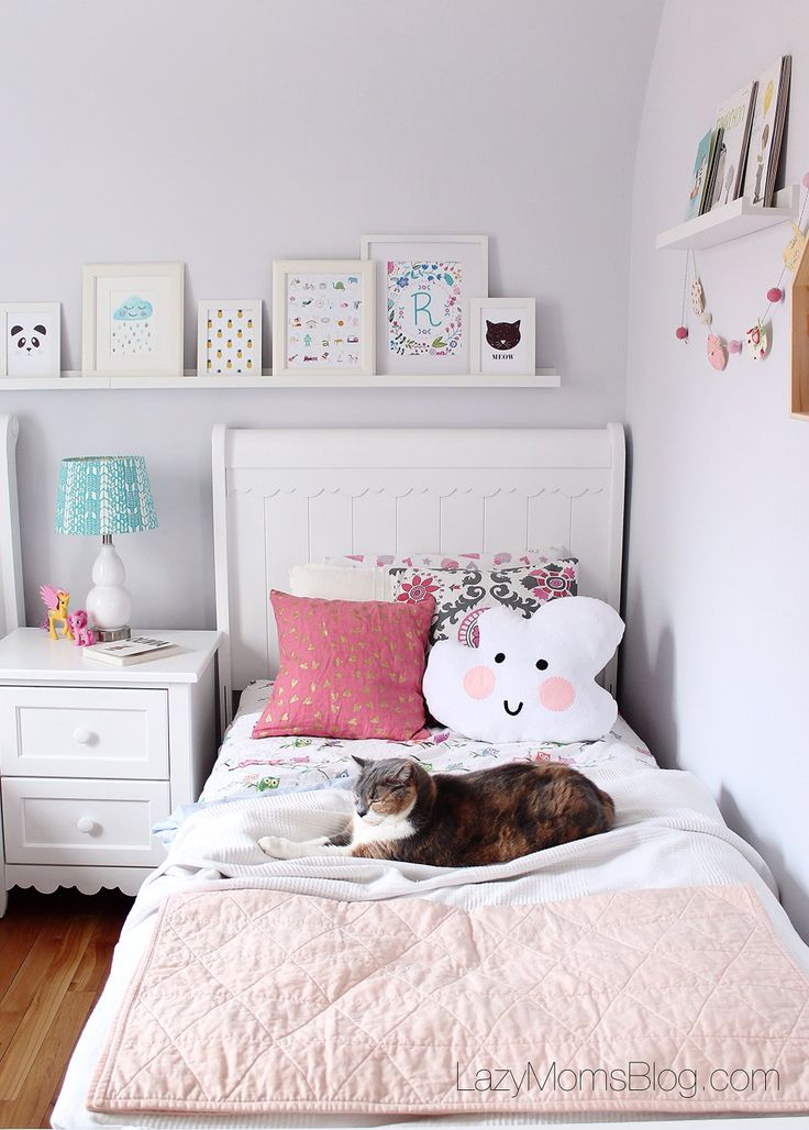 Simple ideas for a small little girls shared bedroom. All pastel and functional too!