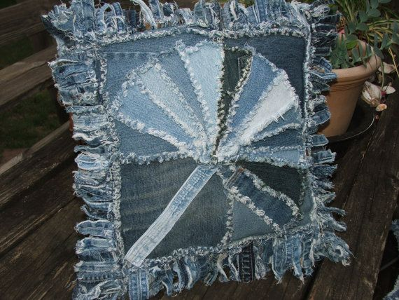 Denim pillow sham with a scrap pieced fan pattern front. The homemade pillow form is included and can be easily removed for washing through the back over lap opening, made from a waistband and pockets from a pair of jeans. Unique and lots of character from worn denim and great for denim decor. Clipped and frayed for that tattered look we love. The edges are created from short cuts of the long seams from jeans and give an interesting fringed appearance. It measures approximately 17 square and…