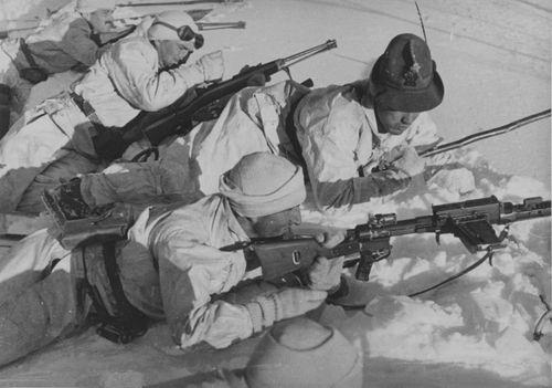 Italian Alpini armed with Moschetto da Cavalleria Mod. 91 carbines and a Fucile Mitragliatore Breda Modello 30 light machine gun in Albania. (Always wear your Tyrolean hat)