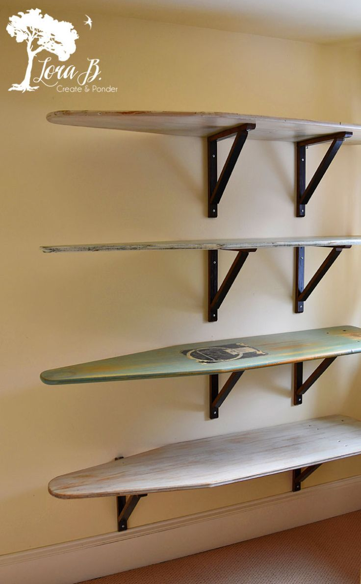 Vintage ironing boards made into shelves. So clever! Perfect for storage or organizing with an antique touch! By Lora B
