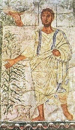 Arte judío. Moisés ante la zarza ardiente, con la bendición de Yahvéh, cuya mano emerge del cielo.1 Fresco parietal proveniente de la Sinagoga de Dura Europos, 244 E.C. Detalle.2