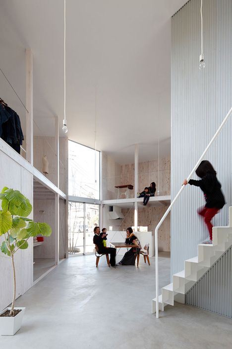 """There are barely any partitions between the rooms of this family house in Chiba Prefecture, Japan, which was designed as an open container that """"changes as you design and live in it"""""""