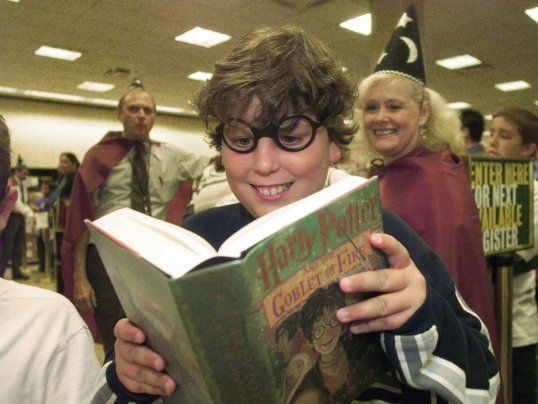 Kid reading Harry Potter and the Goblet of Fire