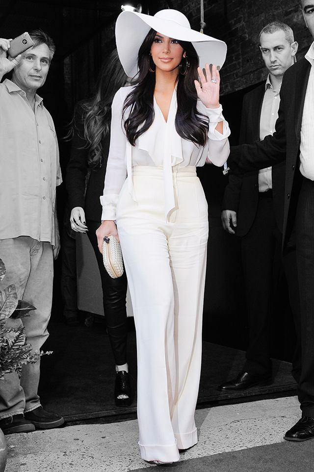 Kim Kardashian going for a 70's glam look #KimKardashian #70's #Glam #Outfit