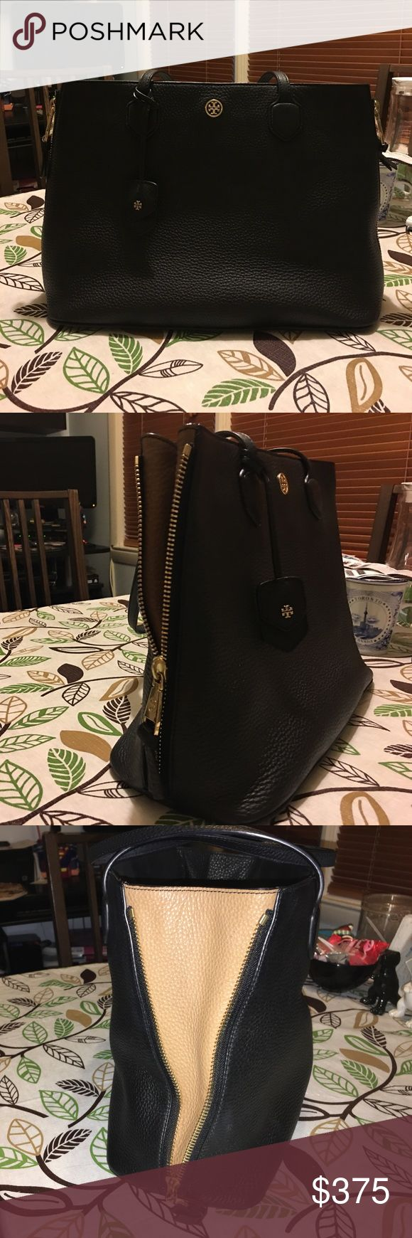 TORY BURCH ROBINSON PEBBLED LEATHER SIDE ZIP TOTE EUC *RARE* TORY BURCH ROBINSON PEBBLED LEATHER SIDE ZIP TOTE BLACK/TAN. ALL CLEAN INTERIOR, NO MARKS STAINS OR TEARS. SEE PICS FOR MORE INFO. Tory Burch Bags Totes