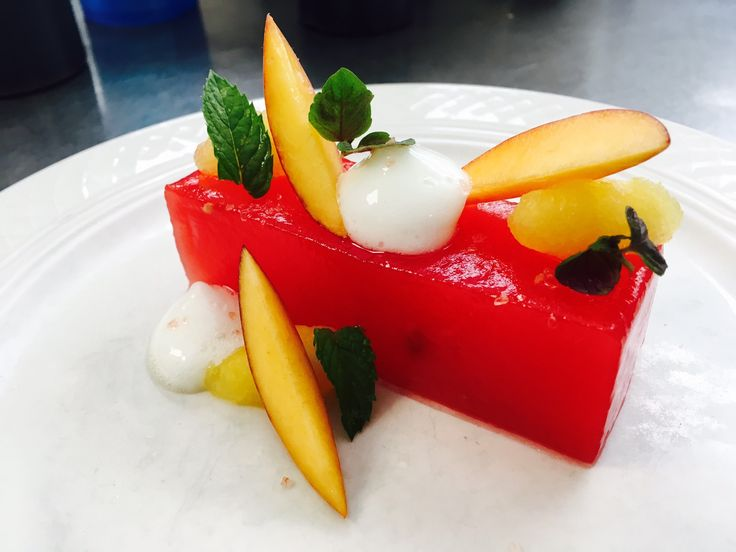 Garden mint, peach, cucumber and sour plum vinegar transform this juicy hunk of #watermelon into the perfect #summer salad. (Restaurant: The Union League Guard House-Gladwyne, PA)