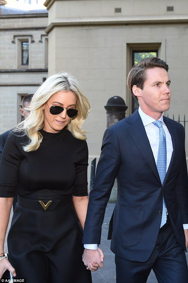 Australian businessman Oliver Curtis (right) clutched the hand of his wife, public relations maven Roxy Jacenko, as the couple strode into court for the first day of his trial facing an insider trading charge