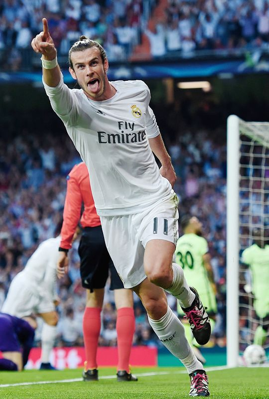..._Gareth Bale celebrates scoring the opening goal during the UEFA Champions League semi final, second leg match between Real Madrid and Manchester City FC at Estadio Santiago Bernabeu on May 4, 2016 in Madrid, Spain.
