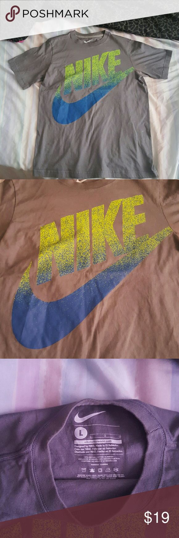 Nike t shirt Boys nike t shirt. Nike letters are in a neon green and blue. Shirt is gray overall. Only work 2x. Lil discoloration near sleeve but BARELY noticeable. 9.5/10 condition. Can fit a womens small. Nike Shirts & Tops Tees - Short Sleeve