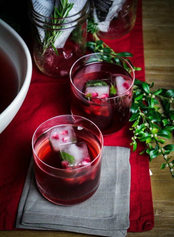 Pomegranate Mojito Punch  Serves 8-10. A Katie at the Kitchen Door original recipe.  1 pomegranate 1 bunch mint, divided Ice cubes 1 c. sugar 2 ½ c. pomegranate juice ½ c. lime juice, preferably freshly squeezed (from 4-5 limes) 2 c. white rum (optional) 2 c. lime seltzer, chilled