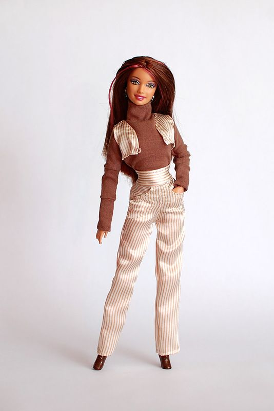 Trouser suit with a waistcoat and a turtleneck