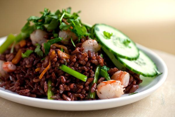 Thai-style fried rice is an addiction in our household. If you cannot find Alter Eco's ruby red jasmine, you can make this dish with red Bhutanese rice or with regular jasmine rice. This may seem like a lot of fried rice, but believe me, you'll finish it in one sitting. (Photo: Andrew Scrivani for The New York Times)