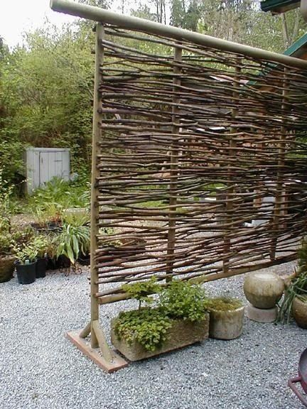 Wattle fencing originated in England and was traditionally woven with willow or hazel branches