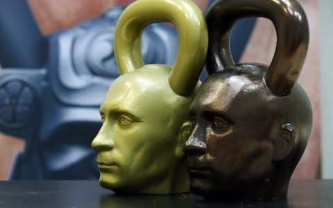 16kg kettlebells shaped as Russian President Vladimir Putin's head on sale in the Heavy Metal shop in Moscow