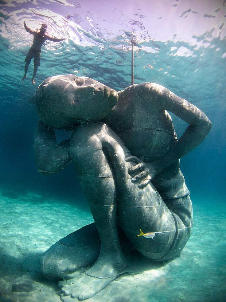 Ocean Atlas off the coast of the Bahamas. The sculpture is over 18 feet tall and weighs 60 tons.