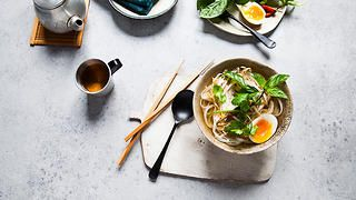 Chicken phở with soft-cooked egg