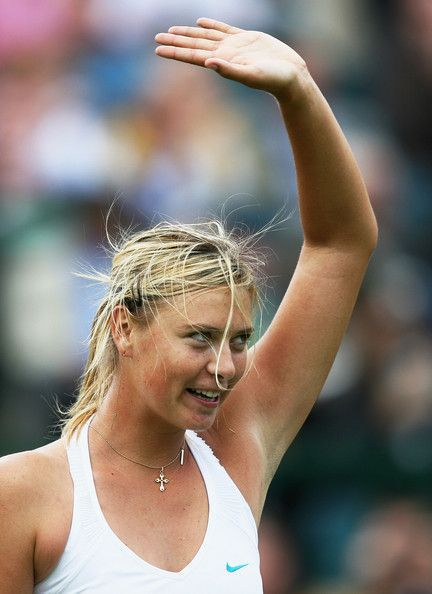 Maria Sharapova of Russia waves to the crowd following the Women's Singles second round match against Severine Bremond of France during day four of the Wimbledon Lawn Tennis Championships at the All England Lawn Tennis and Croquet Club on June 28, 2007 in London, England.