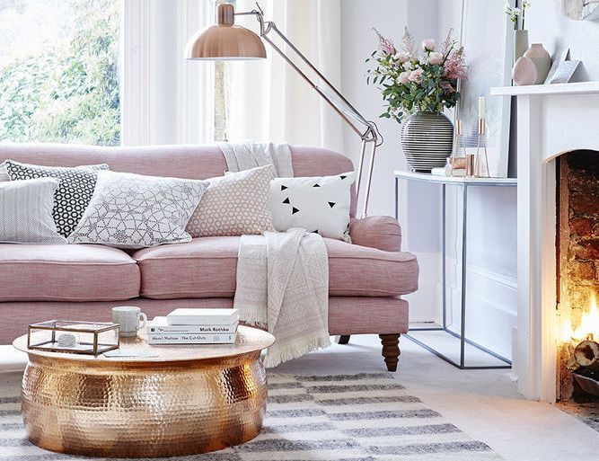 Pink is still a huge interiors trend! Layer soft rose with grey, choose a classic sofa as the room's focal point and introduce pattern with decorative cushions and a rug. Contrast the soft colours with a statement floor lamp and coffee table.   - housebeautiful.co.uk