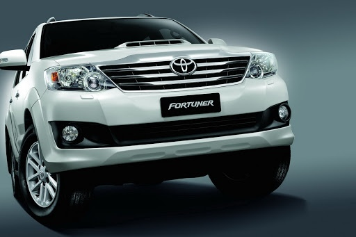Toyota Fortuner cross the city or forest